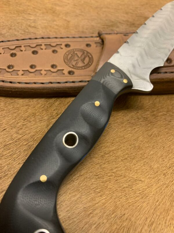 Alexander Conchar - Stainless damascus hunting knife closeup of G10 handle